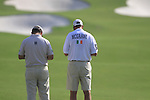 Damien McGrane and caddy study the yardage on the 7th hole during  Day 2 at the Dubai World Championship Golf in Jumeirah, Earth Course, Golf Estates, Dubai  UAE, 20th November 2009 (Photo by Eoin Clarke/GOLFFILE)