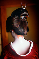 Yachiho-San, Geisha in Kyoto, Japan<br /> <br /> Here in their traditional geisha home or okiya, preparing hair and make-up while dressing for the evening is time consuming. The girls must rely on a strong male dresser to help as their kimonos can weigh up to thirty pounds and trail twenty-five feet in length. Sanbonashi is a special design of three lines of unpainted skin that draws attention to the nape of a geisha's sensual neck, considered to be the most alluring part of a woman's body.