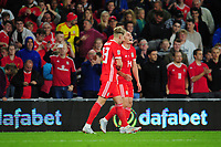 Connor Roberts (right) of Wales celebrates scoring his side's fourth goal with team mate David Brooks (left) during the UEFA Nations League B match between Wales and Ireland at Cardiff City Stadium in Cardiff, Wales, UK.September 6, 2018