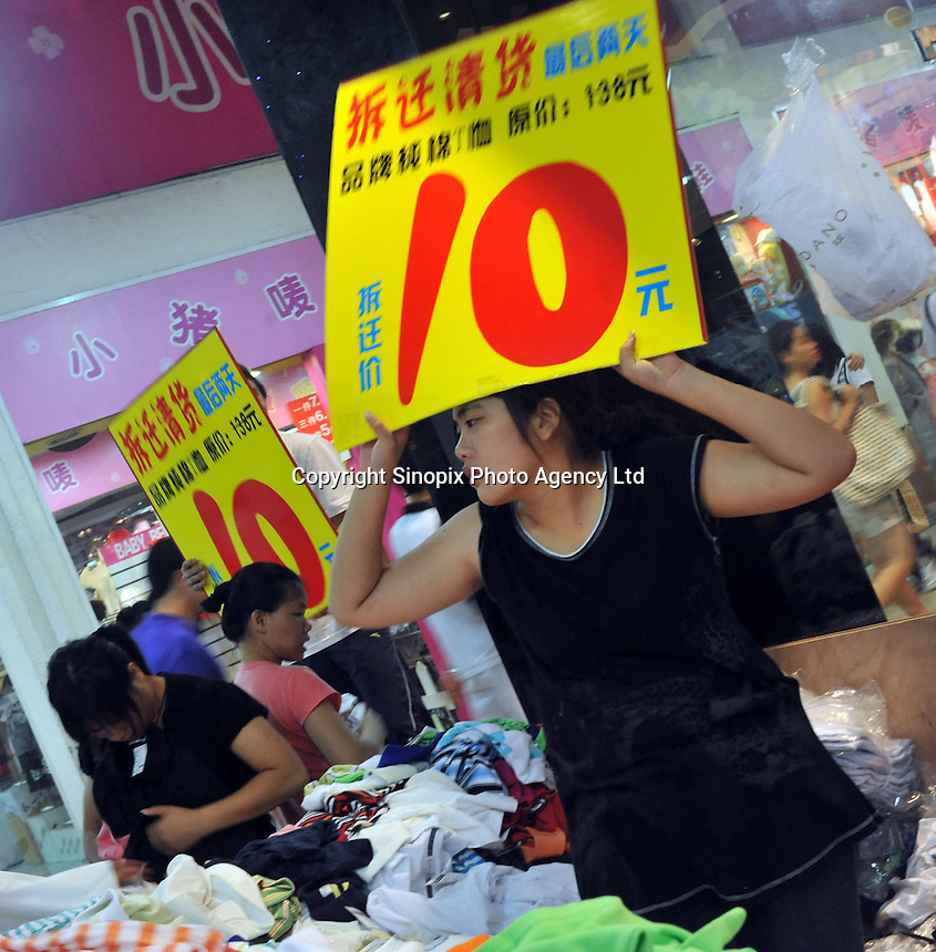 Shoppers scramble for bargains in a shopping centre in Guangzhou, China. The financial crisis won't have too much impact on Chinese consuming market. According to a survey by Nielsen of 50 countries and regions, only 35 percent of Chinese people believed the domestic economy was in a contraction. The figure was the lowest among the 50 world markets..27 Jun 2008