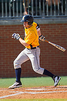 Jesse Puscheck (25) of the Canisius Golden Griffins follows through on his swing against the Charlotte 49ers at Hayes Stadium on February 23, 2014 in Charlotte, North Carolina.  The Golden Griffins defeated the 49ers 10-1.  (Brian Westerholt/Four Seam Images)