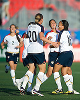 Abby Wambach, Shannon Boxx, Angela Hucles celebrate Boxx's goal. The US Women's National Team defeated the Canadian Women's National Team, 4-0, at BMO Field in Toronto during an international friendly soccer match on May 25, 2009.