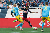 FOXBOROUGH, MA - AUGUST 8: Gustavo Bou #7 of New England Revolution on the attack as Jakob Glesnes #5 of Philadelphia Union defends during a game between Philadelphia Union and New England Revolution at Gillette Stadium on August 8, 2021 in Foxborough, Massachusetts.
