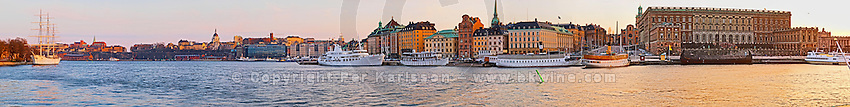 The Swedish Royal Palace in the Gamla Stan, Old Town. In late evening sunshine. The Af Chapman three masted former school tall ship, now anchored off Skeppsholmen and functioning as a youth hostel. Sodermalm in background. Stockholm. Sweden, Europe.