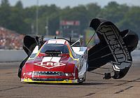Aug 16, 2014; Brainerd, MN, USA; NHRA funny car driver Tim Wilkerson during qualifying for the Lucas Oil Nationals at Brainerd International Raceway. Mandatory Credit: Mark J. Rebilas-