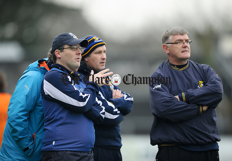 Sixmilebridge manager John O Meara with his mentors on the sideline during the the Munster Club Championship final at Cusack park. Photograph by John Kelly.