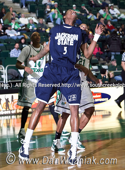 Jackson State Tigers guard Rod Melvin (3) looks for a rebound in the game between the Jackson State Tigers and the University of North Texas Mean Green at the North Texas Coliseum,the Super Pit, in Denton, Texas. UNT defeated Jackson 68 to 49