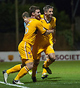 Motherwell's Keith Lasley (right) is congratulated by Robert McHugh after he scores Motherwell's third goal...