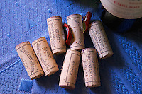 Corks from Chateau La Grave Figeac on a blue table cloth - Chateau La Grave Figeac, Saint Emilion, Bordeaux