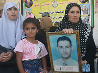 """A Palestinian women attends a protest calling for the release of Palestinian prisoners from Israel jails, in Gaza August 6, 2007. Israeli Prime Minister Ehud Olmert will meet Palestinian President Mahmoud Abbas in the West Bank on Monday, opening talks on broad """"principles"""" for a Palestinian state ahead of a conference later in the year.""""photo by Fady Adwan"""""""