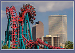 Juxtaposition of near and far. Amusement park and Denver skyline, Colorado. John offers private photo tours in Denver, Boulder and throughout Colorado. Year-round Colorado photo tours.