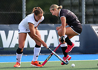 Olivia Shannon of South (L) competes with Alex Lukin during the Women's North v South hockey match, St Pauls Collegiate, Hamilton, New Zealand. Saturday 17 April 2021 Photo: Simon Watts/www.bwmedia.co.nz