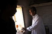 66-year-old Manganiyar artist, Lakha Khan drinks tea before sitting down for field recording of his Sarangi performance in his house in Raneri village of Jodhpur district in Rajasthan, India. Photo: Sanjit Das/Panos