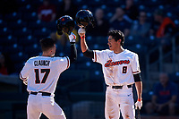 Troy Claunch (17) is congratulated by Cesar Valero Sanchez (8) after hitting a home run during an NCAA game against the New Mexico Lobos at Surprise Stadium on February 14, 2020 in Surprise, Arizona. (Zachary Lucy / Four Seam Images)