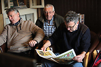 Pictured: Regulars read the Racing Post newspaper before the race at Cresselly Arms pub in Cresswell Quay, Pembrokeshire, Wales, UK. Thursday 16 March 2017<br /> Re: A racehorse owned by a syndicate from Pembrokeshire which was a favourite to win at this year's Cheltenham Festival, has lost.<br /> Tobefair, a seven-year-old gelding, has won his last seven races.<br /> He was gifted as a colt to Michael Cole three years ago, in return for looking after two fillies on his farm.<br /> Unable to afford the training costs on his own, he decided to offer 50% of the ownership to people he knew through his local pub, the Cresselly Arms at Cresswell Quay Quay.<br /> The syndicate grew to 17 members but none except Mr Cole had owned a racehorse before.<br /> They said they were amazed when Tobefair started winning races and never dreamed he would make it to Cheltenham.