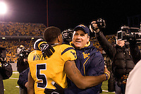 08 November 2007: Rich Rodriguez..The West Virginia Mountaineers defeated the Louisville Cardinals 38-31 on November 08, 2007 at Mountaineer Field, Morgantown, West Virginia.  Rodriguez gives his quarterback Pat White a hug after the game. White scored the game-winning touchdown.