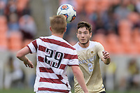 Houston, TX - Friday December 11, 2016: Luis Argudo (2) of the Wake Forest Demon Deacons keeps his eye on the ball against the Stanford Cardinal at the NCAA Men's Soccer Finals at BBVA Compass Stadium in Houston Texas.