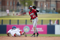 Carolina Mudcats shortstop Freddy Zamora (23) fields a throw from the outfield as Harvin Mendoza (38) of the Kannapolis Cannon Ballers slides into second base at Atrium Health Ballpark on July 18, 2021 in Kannapolis, North Carolina. (Brian Westerholt/Four Seam Images)