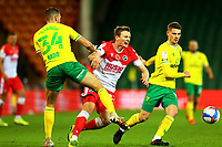 3rd November 2020; Carrow Road, Norwich, Norfolk, England, English Football League Championship Football, Norwich versus Millwall; Ben Gibson of Norwich City fouls Jón Daoi Boovarsson of Millwall