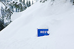 Deep snow in western Montana nearly covering the road sign