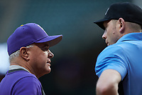 LSU Tigers head coach Paul Mainieri listens to home plate umpire Jason Milsap during the game against the Baylor Bears in game five of the 2020 Shriners Hospitals for Children College Classic at Minute Maid Park on February 28, 2020 in Houston, Texas. The Bears defeated the Tigers 6-4. (Brian Westerholt/Four Seam Images)