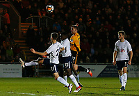 Scot Bennett of Newport County contends with Victor Wanyama and Juan Foyth of Tottenham Hotspur during the Fly Emirates FA Cup Fourth Round match between Newport County and Tottenham Hotspur at Rodney Parade, Newport, Wales, UK. Saturday 27 January 2018