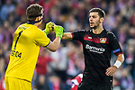 Aleksandar Dragovic (r) of Bayer 04 Leverkusen talks with goalkeeper Bernd Leno of Bayer 04 Leverkusen during their 2016-17 UEFA Champions League Round of 16 second leg match between Atletico de Madrid and Bayer 04 Leverkusen at the Estadio Vicente Calderon on 15 March 2017 in Madrid, Spain. Photo by Diego Gonzalez Souto / Power Sport Images
