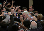 RALEIGH, NC - OCTOBER 31:  Former president Bill Clinton poses for a picture with the crowd at a campaign event in support of North Carolina's Democratic incumbent for U.S. Senate Kay Hagan at Broughton High School in Raleigh, NC, on Friday, October 31, 2014.  (Photo by Ted Richardson/For The Washington Post)
