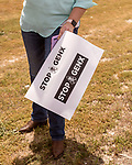 May 5, 2018. Fayetteville, North Carolina.<br /> <br /> Beth Markesino holds a sign about the GenX pollution of the Cape Fear River on Hwy. 87 just outside the Chemours plant which has been dumping GenX unregulated into the river for years. <br /> <br /> The Chemours Company, a spin off from DuPont, manufactures many chemicals at its plant in Fayetteville, NC. One of these, commonly referred to as GenX, is part of the process of teflon manufacturing. Chemours has been accused of dumping large quantities of GenX into the Cape Fear River and polluting the water supply of city's down river and allowing GenX to leak into local aquifers.