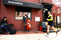 Howie Alexander and Tony DePaolis play in front of Con Alma in the Shadyside neighborhood on Saturday April 11, 2020 in Pittsburgh, Pennsylvania. (Photo by Jared Wickerham/Pittsburgh City Paper)