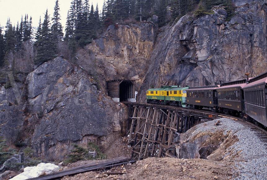 Train entering a small rock tunnel, Alaska