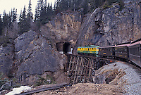 Train entering a small rock tunnel, Alaska