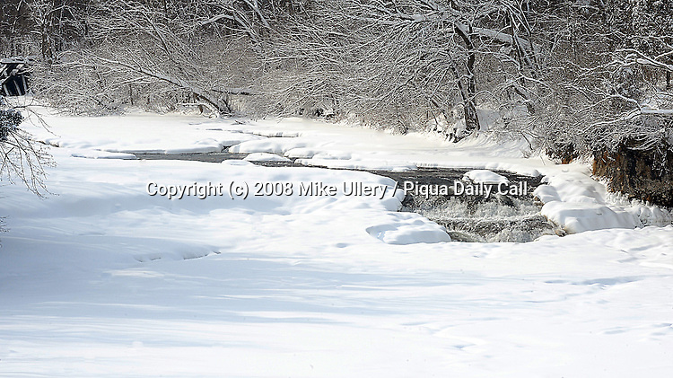 Staff Photo/Mike Ullery, Piqua Daily Call.Greenville Falls near Covington, Ohio is nearly covered after nearly a foot of snow fell across the Miami Valley January 27 and 28.