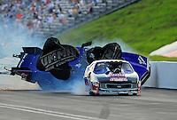 Jun. 18, 2011; Bristol, TN, USA: NHRA pro mod driver Roger Burgess crashes behind Kenny Lang during eliminations at the Thunder Valley Nationals at Bristol Dragway. Mandatory Credit: Mark J. Rebilas-