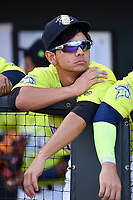 Infielder Andres Gimenez (13) of the Columbia Fireflies in the dugout before a game against the Augusta GreenJackets on Saturday, July 29, 2017, at Spirit Communications Park in Columbia, South Carolina. Columbia won, 3-0. (Tom Priddy/Four Seam Images)