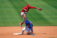 St. Louis Cardinals shortstop Edmundo Sosa (63) jumps over Michael Conforto  (30) on a double play attempt during a Major League Spring Training game against the New York Mets on March 19, 2021 at Clover Park in St. Lucie, Florida.  (Mike Janes/Four Seam Images)