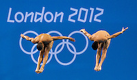 30 JUL 2012 - LONDON, GBR - Jose Antonio Guerra (CUB) and Jeinkler Aguirre (CUB) of Cuba  diving during the Mens 10m Synchronised Diving at the London 2012 Olympic Games event in the Aquatics Centre in the Olympic Park, Stratford, London, Great Britain .(PHOTO (C) 2012 NIGEL FARROW)