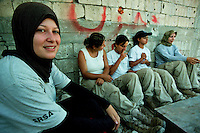 MAALIYE / SUD LIBANO - LUGLIO 2007.DONNE LIBANESI OPERANO COME SMINATRICI NEI VILLAGGI DISTRUTTI DALLE FORZE ISRAELIANE NEL SUD DEL LIBANO..IN PRIMO PIANO NELLA FOTO, SARA KAZZIR, 19 ANNI, VIENE DA DYR KANOUN, UN VILLAGGIO NELLA ZONA DI CONFINE TRA LIBANO E ISRAELE RIDOTTO IN MACERIE..FOTO LIVIO SENIGALLIESI..MAALIYE / SOUTH LEBANON - JULY 2007.FEMALE DEMINING TEAM WORKING FOR MAG IN THE DESTROYED VILLAGES OF SOUTH LEBANON..IN THE PICTURE MS.SARA KAZZIR, 19, COMING FROM DYR KANOUN, VILLAGE DESTROYED BY ISRAELI TROOPS DURING THE OFFENSIVE AGANINST HEZBOLLAH GUERRILLA IN 2006..PHOTO LIVIO SENIGALLIESI