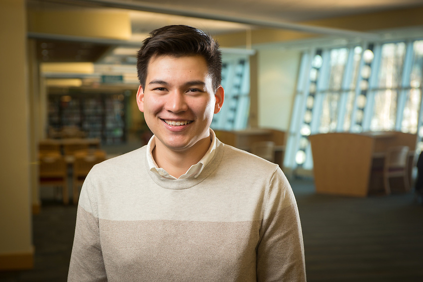 2017 Truman Scholar and current Seawolf Debate and Model UN participant Jacob Shercliffe photographed in UAA's Consortium Library.