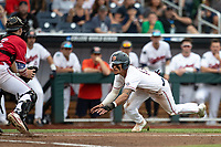 Auburn Tigers shortstop Will Holland (17) slides head first into home during Game 7 of the NCAA College World Series against the Louisville Cardinals on June 18, 2019 at TD Ameritrade Park in Omaha, Nebraska. Louisville defeated Auburn 5-3. (Andrew Woolley/Four Seam Images)