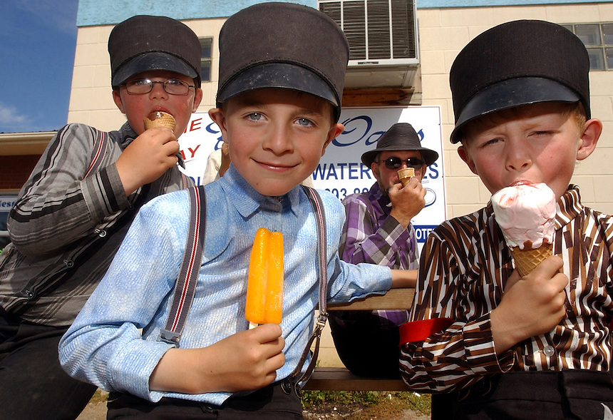 """After a morning of picking apples in 30 C heat, members of the Baildon Hutterite Colony cool off with ice cream at the Snow Hut in Moose Jaw. This is one of my favourite photos from my time in Moose Jaw. I like it because it doesn't depict these kids as some kind of """"other."""" It depicts them as people who, like everyone else, enjoy a cold treat on a hot day. From left to right is Eli Wipf, 7, cousin Joshua Wipf, 7, Peter Wipf, and Kevin Hofer, 6."""