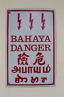 Electricity Danger Warning Sign in Five Languages:  Malaysian, English, Chinese, Tamil, and Hindi.  Ipoh, Malaysia.