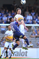 MELBOURNE, AUSTRALIA - JANUARY 26, 2010: Carlos Hernandez from Melbourne Victory tackles Tim Brown as they leap for the ball in round 19 of the A-league match between Melbourne Victory and Wellington Phoenix FC at Etihad Stadium on January 26, 2010 in Melbourne, Australia. Photo Sydney Low www.syd-low.com