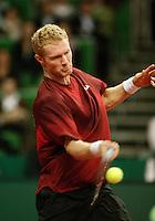 10-2-06, Netherlands, tennis, Amsterdam, Daviscup.Netherlands Russia,  Dmitry Tursonov in action against Raemon Sluiter.