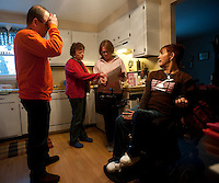 Kara talks to her parents and sister about her transportation situation after the accident with her van before a family dinner at her parents's house.  Photo by James R. Evans ©