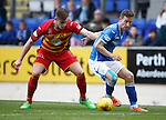 St Johnstone v Partick Thistle....17.10.15  SPFL     McDiarmid Park, Perth<br /> Steven MacLean fends off Liam Lindsay<br /> Picture by Graeme Hart.<br /> Copyright Perthshire Picture Agency<br /> Tel: 01738 623350  Mobile: 07990 594431