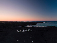 """The word """"LOVE"""" spelled with white coral on lava rock, Kona, Big Island."""