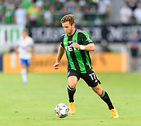 AUSTIN, TX - JUNE 19: Jon Gallagher #17 of Austin FC brings the ball up the field during a game between San Jose Earthquakes and Austin FC at Q2 Stadium on June 19, 2021 in Austin, Texas.