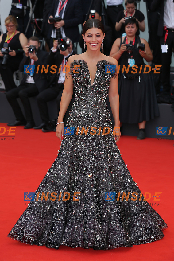"""VENICE, ITALY - AUGUST 28: Alessandra Mastronardi walks the red carpet ahead of the Opening Ceremony and the """"La Verite"""" (The Truth) screening during the 76th Venice Film Festival at Sala Grande on August 28, 2019 in Venice, Italy., 2019 in Venice, Italy. (Photo by Marck Cape/Inside Foto)<br /> Venezia 28/08/2019"""