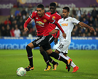 (L-R) Chris Smalling of Manchester United chased by Wayne Routledge of Swansea City during the Carabao Cup Fourth Round match between Swansea City and Manchester United at The Liberty Stadium, Swansea, Wales, UK. Tuesday 24 October 2017